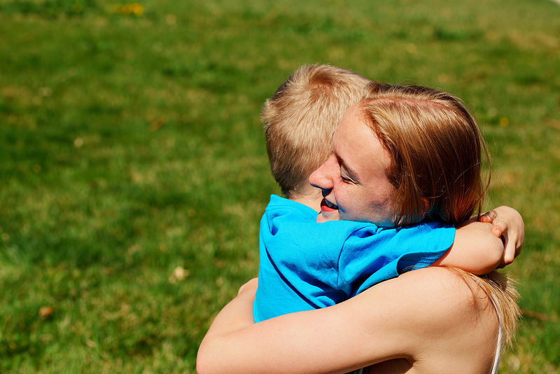 child and mum hug